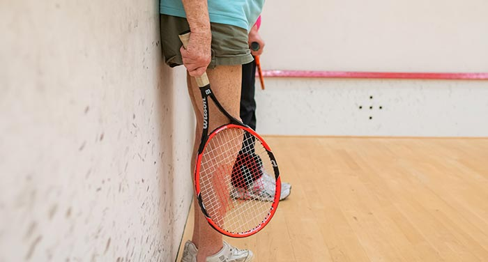 Someone holding a tennis racket