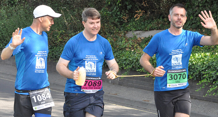 3 Men running a marathon