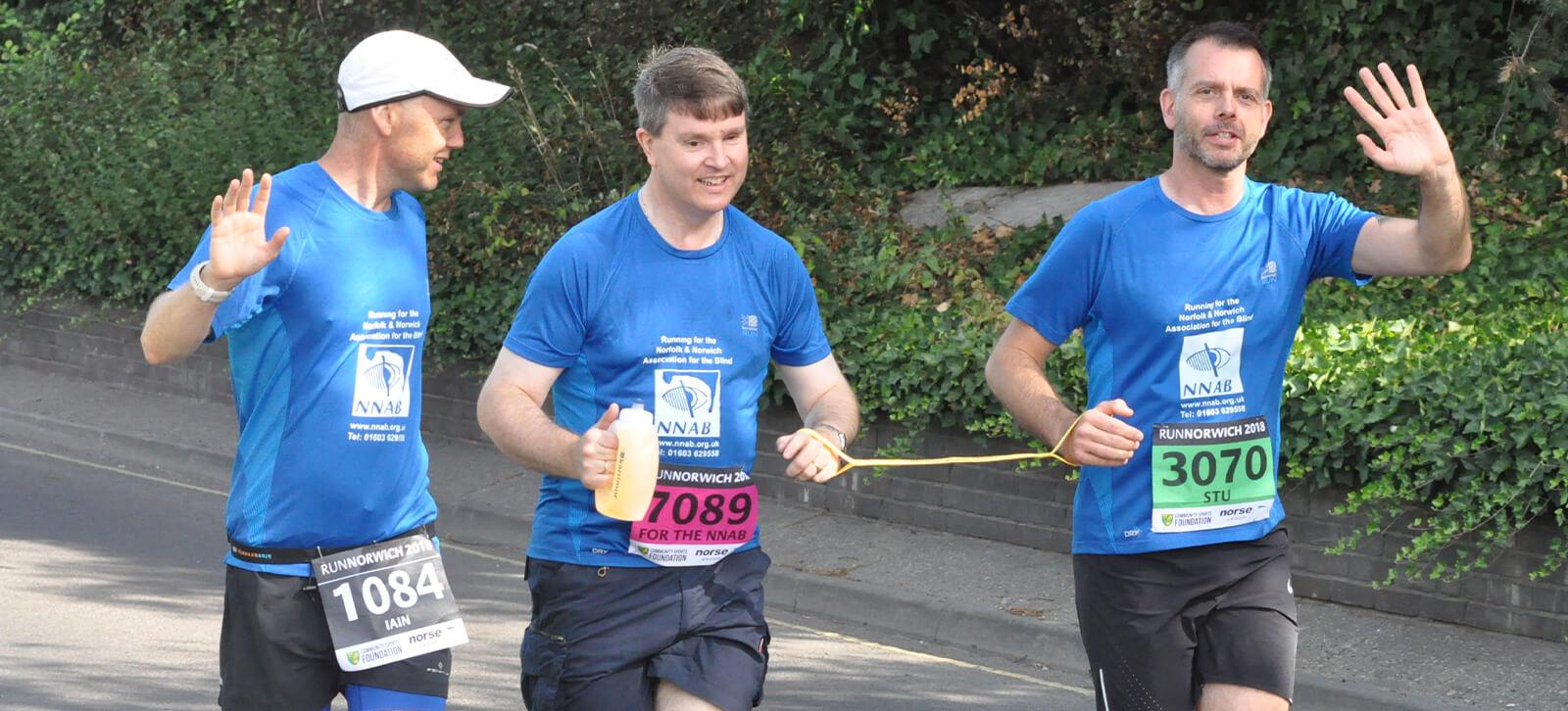 3 Men running a marathon