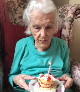 103 Year Old Annie Nicholls Blowing Out A Candle On Her Birthday Cake